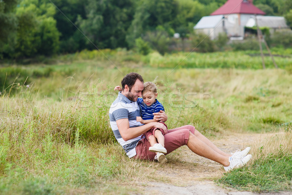Father and son spending time together hugging Stock photo © O_Lypa