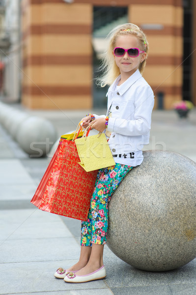 Fashionably dressed little girl with shopping bags Stock photo © O_Lypa