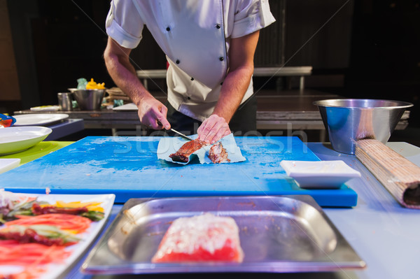 Sushi chef cuts the eel in the kitchen Stock photo © O_Lypa
