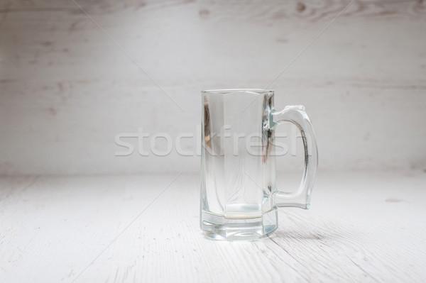 Empty Beer Mug on a light background Stock photo © O_Lypa