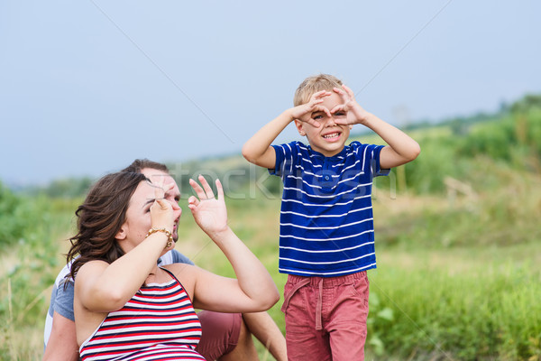 Child making pretend binoculars with hands Stock photo © O_Lypa