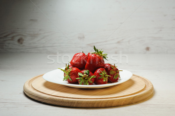 Juicy, tasty strawberries on a plate Stock photo © O_Lypa