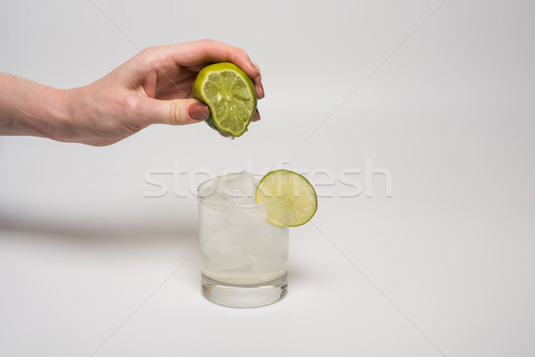 Female hand squeezing lime Stock photo © O_Lypa