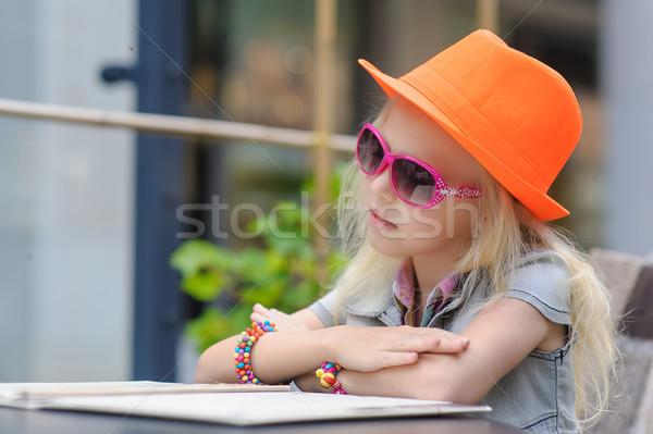 Pretty child reading menu in the cafe Stock photo © O_Lypa