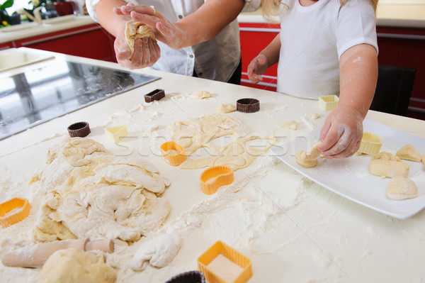Hands of  child knead dough  Stock photo © O_Lypa