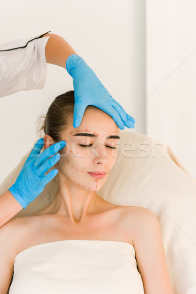 Cosmetic surgeon examining female client in office Stock photo © O_Lypa