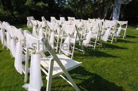 White decorated chairs on a green lawn Stock photo © O_Lypa