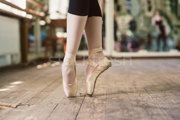 Feet of ballerina dancing in ballet shoes Stock photo © O_Lypa