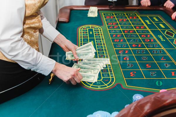 Pénz játék rulett asztal ház férfi Stock fotó © O_Lypa