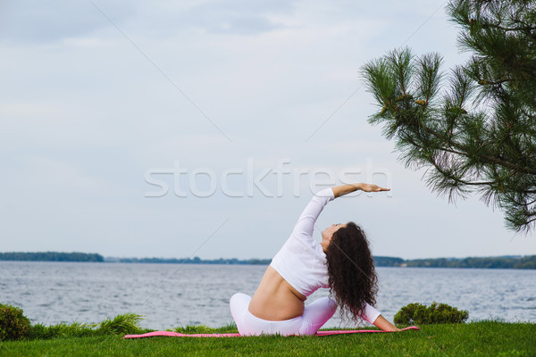 Terhes nő gyakorol jóga vmi mellett folyó terhes Stock fotó © O_Lypa