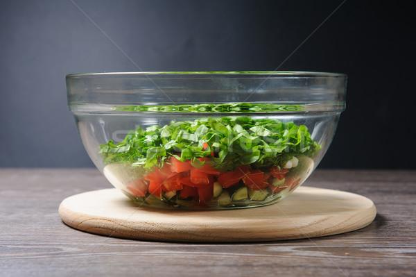 Glass salad bowl on a table Stock photo © O_Lypa