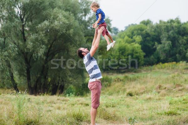Apa dob felfelé kicsi fiú fiatal Stock fotó © O_Lypa