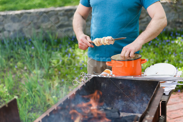 Man stringing meat on a skewer Stock photo © O_Lypa