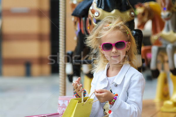 Child with shopping bags reviewing purchases Stock photo © O_Lypa