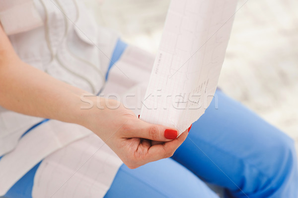 Electrocardiogram, ecg in hand, palm of doctor. Stock photo © O_Lypa