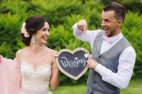 Romantic couple holding heart Stock photo © O_Lypa