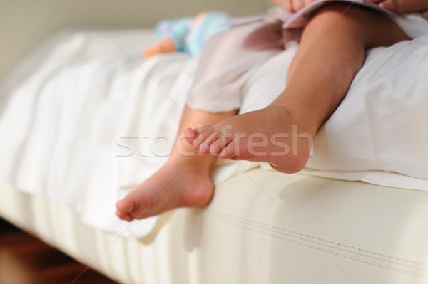 Mezítláb ül ágy baba gyerekek láb Stock fotó © O_Lypa