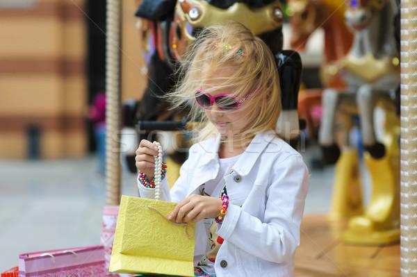 Gyermek bevásárlótáskák öreg francia körhinta ünnep Stock fotó © O_Lypa