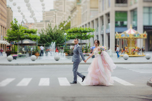 Happy newlyweds cross the street Stock photo © O_Lypa