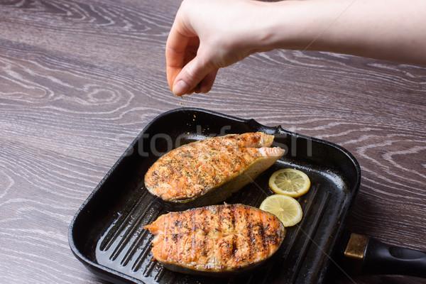 Grilled salmon Steak on grill pan Stock photo © O_Lypa