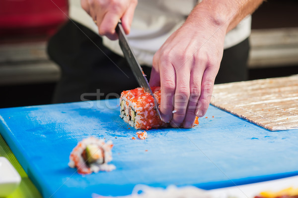 Japanese chef prepares food. Stock photo © O_Lypa