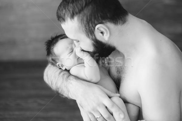 Happy father holding a baby boy Stock photo © O_Lypa