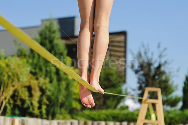 Girl walking on the sling Stock photo © O_Lypa