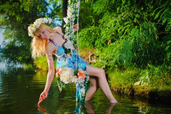 Lány hinta folyó házi fa díszített Stock fotó © O_Lypa
