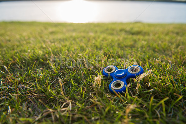 Tri Fidget Hand Spinner on the grass Stock photo © O_Lypa