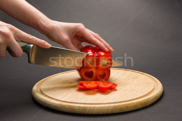 Slicing red pepper on chopping board Stock photo © O_Lypa