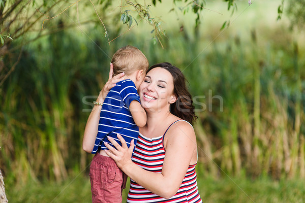 Happy mother and her son hugging Stock photo © O_Lypa