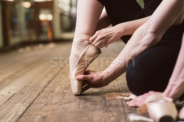 Ballerina putting on her ballet shoes Stock photo © O_Lypa
