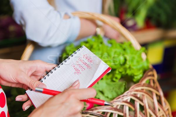 Fiatal nő lista lány notebook kezek vásárlás Stock fotó © O_Lypa