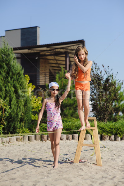 Two girls having fun on sling Stock photo © O_Lypa