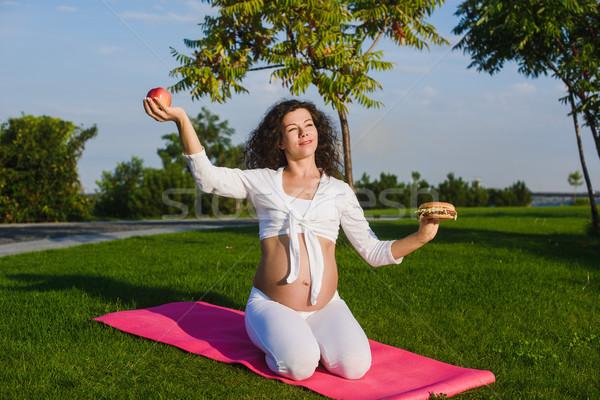 Woman choosing between a hamburger and apple. Stock photo © O_Lypa