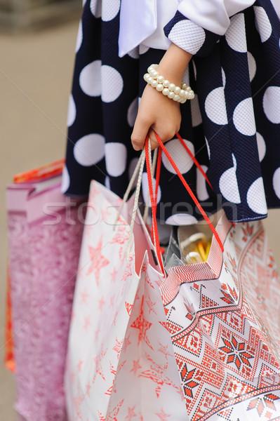 Kislány tart szatyrok bevásárlótáskák kar karkötő Stock fotó © O_Lypa