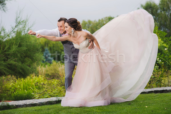 Newlyweds in a superman pose Stock photo © O_Lypa