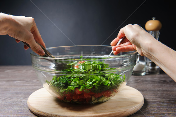 Girl stirs cooked vegetarian vegetable salad Stock photo © O_Lypa