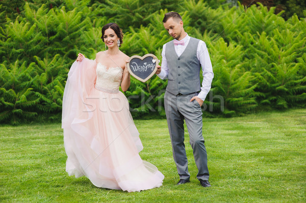 Boldog menyasszony szomorú vőlegény tart szív Stock fotó © O_Lypa