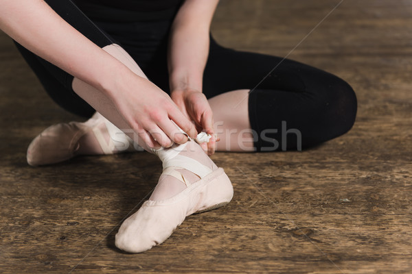 Putting ballet shoes Stock photo © O_Lypa