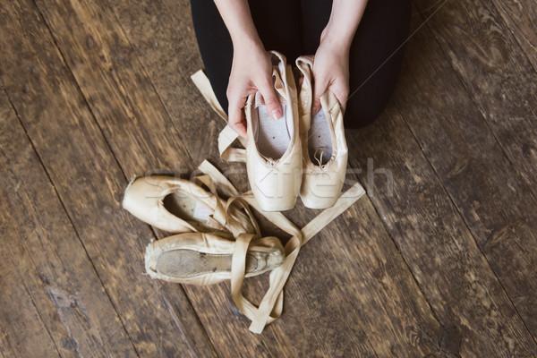 Stock photo: Ballet dancer holding a ballet pointe