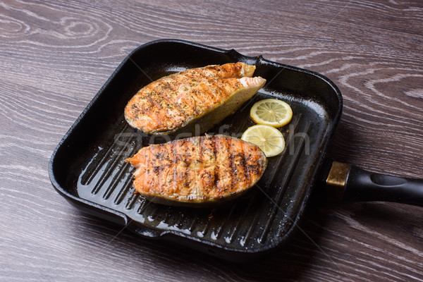 Grilled salmon Steak on grill pan Stock photo © O_Lypa