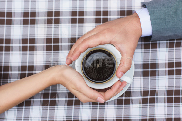 Amantes juntos copo café mãos Foto stock © O_Lypa