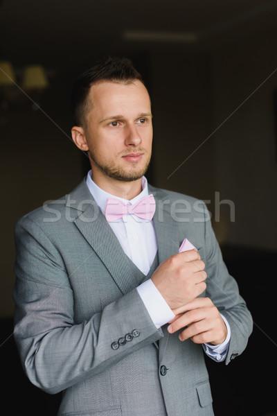 молодым человеком одевание вверх свадьба празднования элегантный Сток-фото © O_Lypa