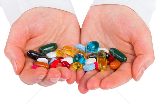 Pillen handen foto kleurrijk medische Stockfoto © Obencem