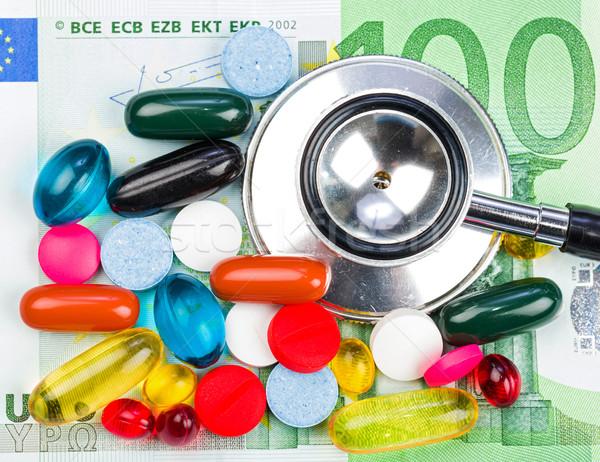 Pillen geld foto kleurrijk stethoscoop Stockfoto © Obencem
