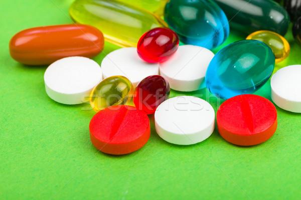 Kleurrijk pillen foto groene geïsoleerd Stockfoto © Obencem