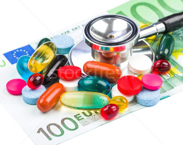 таблетки деньги фото красочный стетоскоп Сток-фото © Obencem