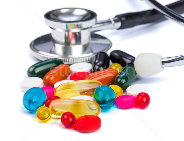 Kleurrijk pillen foto stethoscoop geïsoleerd Stockfoto © Obencem