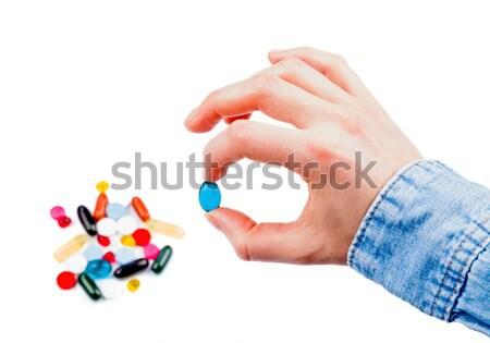Pillen hand foto kleurrijk geïsoleerd Stockfoto © Obencem